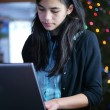 Teen girl working on laptop — Stock Photo