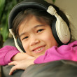 Six year old listening to music — Stock Photo #3126896