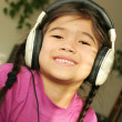 Six year old listening to music — Stock Photo #3126898