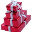 Stack of red presents isolated on white. — Stock Photo