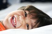 Happy little toddler boy lying down — Stock Photo