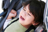 Toddler crying in stroller — Stock Photo