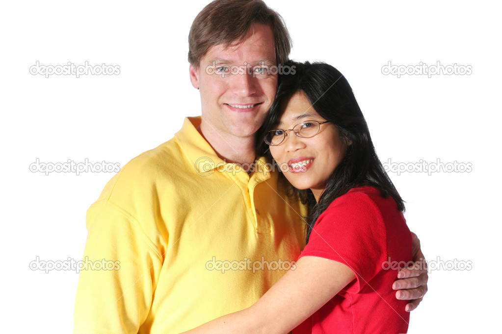 Young family isolated on white. Husband is caucasian Scandinavian descent, wife is Thai. — Stock Photo #3126928