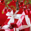 Stock Photo: Elegant red presents under Christmas tree with d