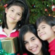 Three happy sisters with Christmas presents — Stock Photo