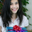 Teen girl with presents — Stock Photo