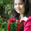Happy child with Christmas gift — Stockfoto
