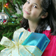 Happy child with Christmas gift — 图库照片