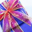 Elegant dark blue present wrapped with red ribbo — Stock Photo
