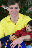 Father and child on Christmas morning — Stock Photo