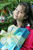 Happy child with Christmas gift — Stock Photo