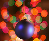 Blue frosted Christmas ornament with colorful li — Stock Photo