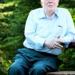 Elderly man enjoying his rest outdoors — Stock Photo #3519175