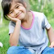 Child sitting on grass — Stock Photo
