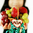 Foto Stock: Child holding small fruit basket