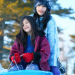Two girls sledding — Stock Photo #3519272