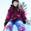 Stock Photo: YOung girl on snow hill