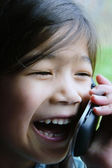 Six year old girl talking on cell phone.; — Stock Photo