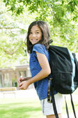 Eight year old girl excited about first day of school.; — Stock Photo