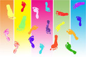 Actual footprints made by children on colorful background — Foto Stock