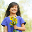 Girl holding bouquet of sunflowers - 图库照片