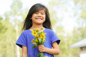 Girl holding bouquet of sunflowers — Stock Photo