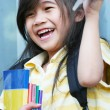 Royalty-Free Stock Photo: Girl excited about her new schoolbooks