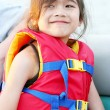 Royalty-Free Stock Photo: Little girl in life vest in boat