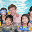 Royalty-Free Stock Photo: Family swimming in pool