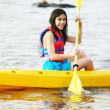 Girl in kayak on lake - Stock Photo