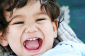 Baby boy mouth wide open in a big smile — Stock Photo