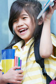 Girl excited about her new schoolbooks — Stock Photo