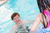 Father teaching child to swim — Stock Photo