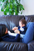 Mother playing with her baby boy — Stock Photo