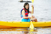 Girl in kayak on lake — Foto de Stock