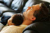 Baby asleep on his father's chest.; — Stock Photo