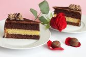 Chocolate cake with rose and candies — Stock Photo