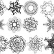 Stock Vector: Set of snowflakes isolated on white background