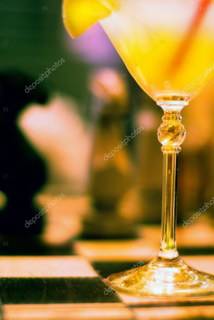 Cocktail drink on a bar, blurry bar background  Stock Photo #3407749