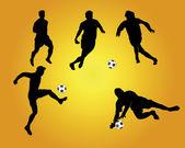 Silhuetas de futebol — Vetor de Stock