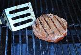 Flipping hamburger — Stock Photo