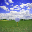 Royalty-Free Stock Photo: Golf ball on the blue sky