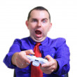 Business man playing videos game — Stock Photo