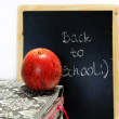 Back to school written on chalkboard — Stock Photo