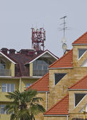 Roofs of Sochi,Russia.(Mobile phone tower.). — Stock Photo