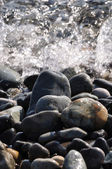 Pebble and wave. — Stock Photo