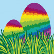 Two rainbow easter eggs hidden in the grass — Stock Photo