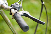 Bicycle grip and skid on grass — Stock Photo