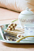 Tea and cake dessert breakfast at bed — Stock Photo