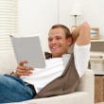 Smiling man reading book — Stock Photo
